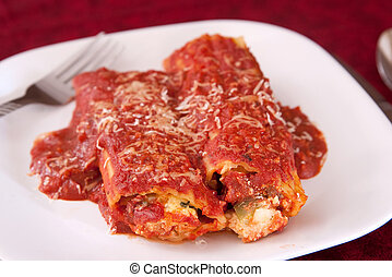 manicotti dinner - two manicotti pasta rolls stuffed with...