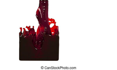 oil. red liquid fills up a rectangular container - close-up...