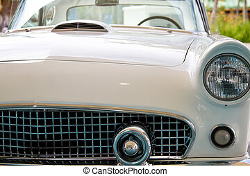 Thunderbird - Three quarter frontal view of a vintage white...