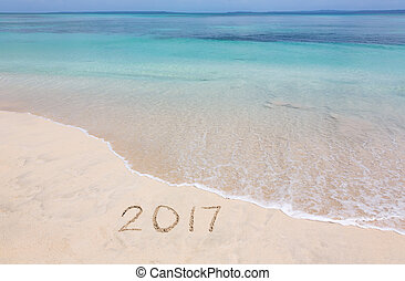 Year 2017 on sandy beach - Happy New Year 2017 creative on...