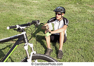 mountain biker drinking and resting