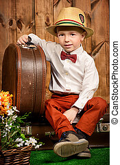 boy with suitcase - Cute little boy in elegant clothes...