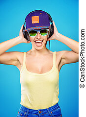girl in music - Modern young woman enjoys listening to music...