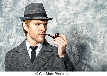 detective style - Handsome young man wearing classic hat and...