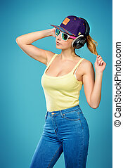 casual sports - Modern young woman enjoys listening to music...