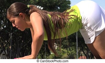 Fit Young Female Doing Pushups