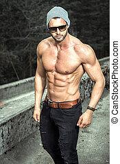 Shirtless man posing outdoor - Stylish muscle man posing...