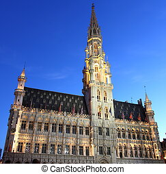 City hall in Brussel at twillight illuminated during light...