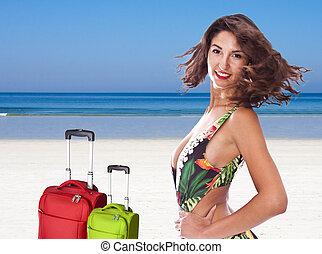young woman on the beach in bikini