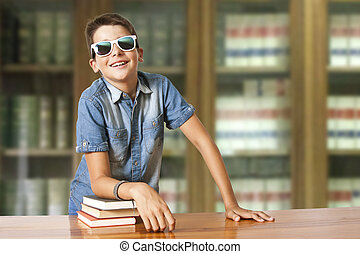boy with books in the school library
