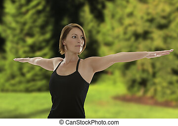Woman doing Yoga Asana Warrior Pose