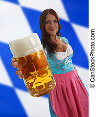 Bavarian Waitress holding Oktoberfest Beer with a bavarian...