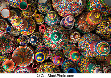 Composition of artistic painted handcrafted pottery jars -...