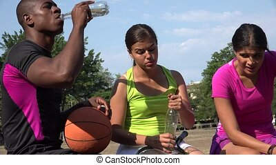 Athletic People Drinking Bottled Water
