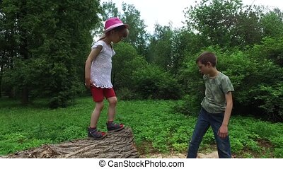 Brother helps sister. Boy teenager drags the the girl child...