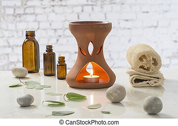 Aromatherapy votive candles burning in essential oil...