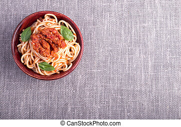 Top view of a gray mat with a small portion of cooked...