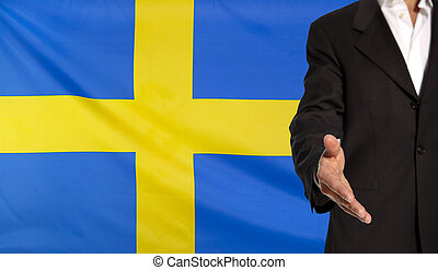 Open hand and Sweden flag in the background - Businessman...