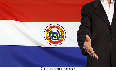 Open hand and Paraguay flag in the background - Businessman...