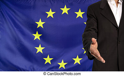 Open hand and Europe flag in the background - Businessman...