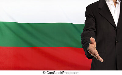 Open hand and Bulgaria flag in the background - Businessman...