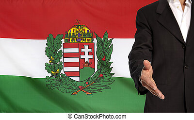 Open hand and Hungary Coat of Arms flag in the background -...