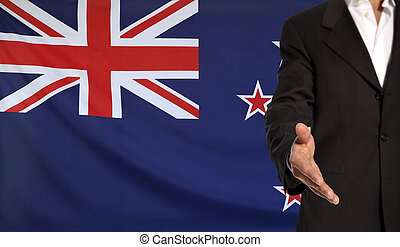Open hand and New Zealand flag in the background -...