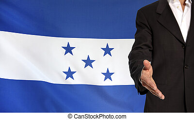 Open hand and Honduras flag in the background - Businessman...
