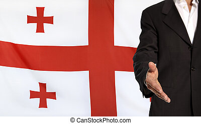 Open hand and Georgia flag in the background - Businessman...