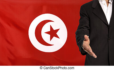 Open hand and Tunesia flag in the background - Businessman...