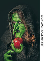 Angry witch with a rotten apple - Angry witch with long hair...