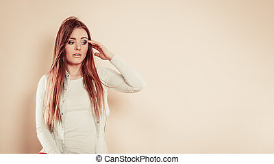 Worried woman with hand on head - Negative emotions...