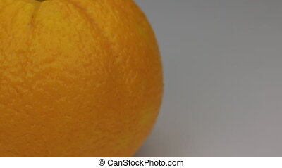 Close-up rotation of mandarin, on a white background, with...