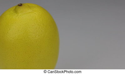 Close-up rotation of lemon, on a white background, with...