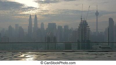 Woman bathing in rooftop pool Kuala Lumpur, Malaysia - Slow...