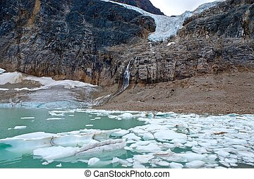 Icebergs in moraine lake, glacier and waterfalls. - Angel...