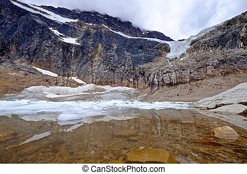Reflection in a moraine lake with icebergs. - Angel Glacier...