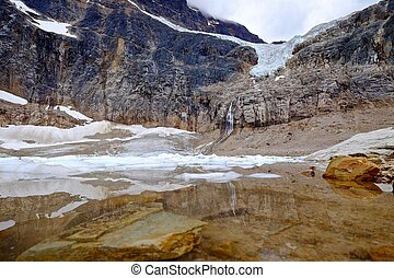 Alpine lake with underwater rocks and icebergs. - Angel...