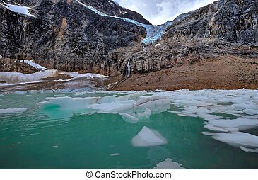 Moraine lake with icebergs under Angel Glacier. - Angel...
