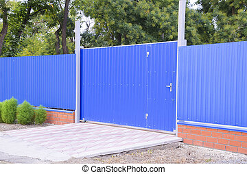 Blue gate and fence. Fence of the private house with blue...