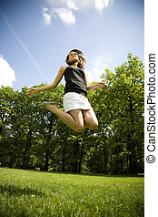 Free Time - Happy Young Woman Is Jumping