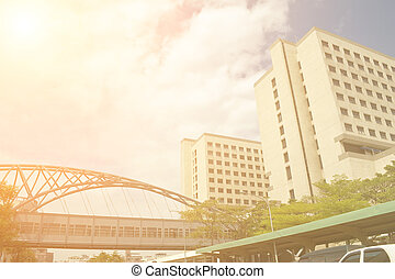 Cityscape of buildings and bridge under blue sky in Tainan,...
