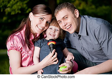 Family Lifestyle Portrait Of A Mum And Dad With Their Kid...
