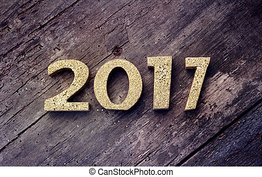 new year 2017 - golden 2017 figures on a old plank
