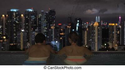 In pool on roof of a hotel in Kuala Lumpur, Malaysia man...