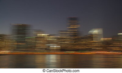 blurred skyline manhattan by night pan shot
