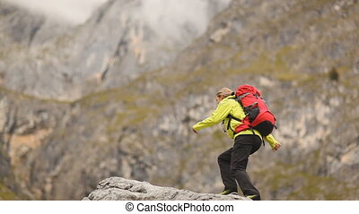 happy woman on mountaintop - happy hiking woman reaching top...