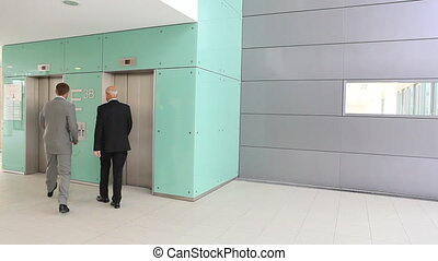 woman catching elevator TWO TAKES