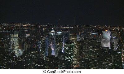 pan shot manhattan by night - Aerial view pan shot over...