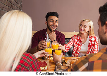 Young People Group Man And Woman Sitting In Burger Cafe,...